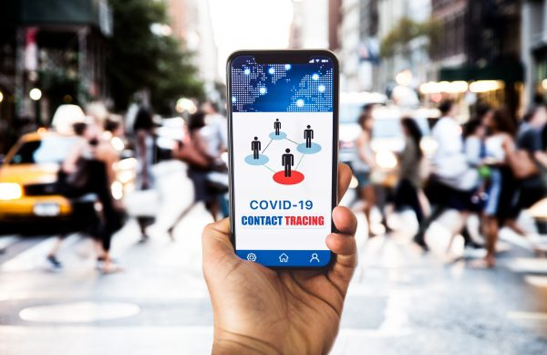 Mobile APP contact tracing adopted by national Governments to stop Covid-19 pandemic. This image is in New York City.  Note for inspectors: All the elements in the image are produced by me.